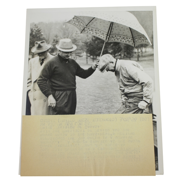 President Eisenhower Putting on Rain Gear with Sam Snead Holding Umbrella 7 1/8x9 Wire Photo